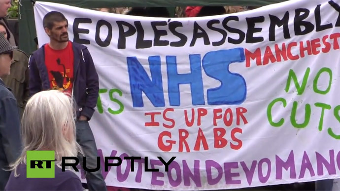 'No more austerity': Demonstrators gather in Manchester to protest cuts, Tory govt