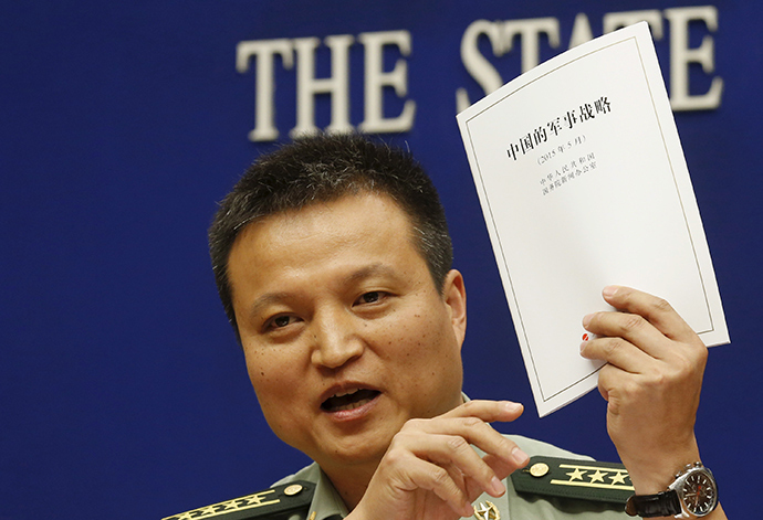 Spokesperson of Chinese Ministry of National Defense Senior Colonel Yang Yujun holds a copy of the annual white paper on China's military strategy during a news conference in Beijing, China, May 26, 2015 (Reuters / Kim Kyung-Hoon)