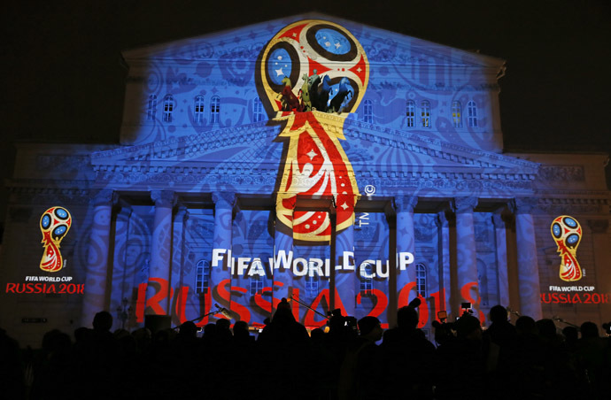 Journalists look at a light installation showing the official logotype of the 2018 FIFA World Cup during its unveiling ceremony at the Bolshoi Theater building in Moscow, October 28, 2014.(Reuters/Maxim Shemetov)