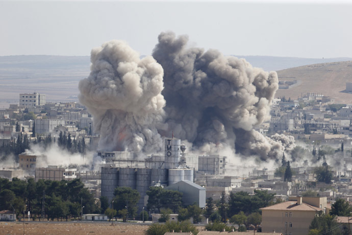 Smoke rises after an U.S.-led air strike in the Syrian town of Kobani on October 8, 2014. (Reuters/Umit Bektas)