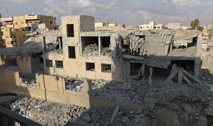 A general view shows a school for the deaf and mute, destroyed in what activists said were overnight U.S.-led air strikes against the Islamic State, in Raqqa November 24, 2014. (Reuters/Nour Fourat)