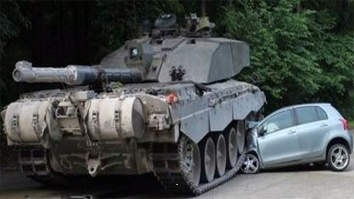 Teenage German girl narrowly cheats death as her car is crushed... by British tank (VIDEO)