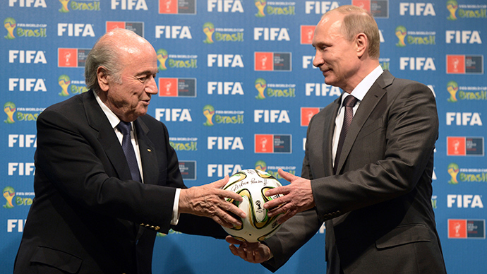 Russia's President Vladimir Putin (R) and FIFA President Sepp Blatter take part in the official hand over ceremony for the 2018 World Cup scheduled to take place in Russia, in Rio de Janeiro July 13, 2014 (Reuters / Alexey Nikolsky)