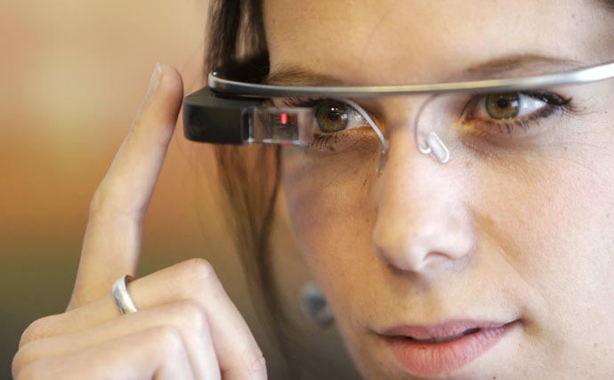 A woman wears Google glasses after a media presentation of a Google apartment in Prague May 15, 2014. (Reuters/David W Cerny)