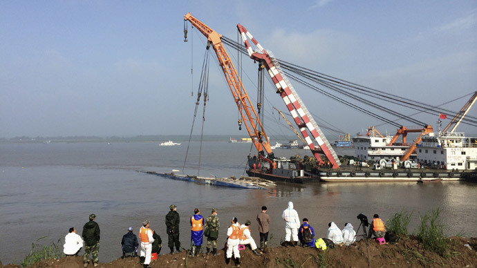 Chinese rescuers overturn capsized ship as disaster toll jumps above 100