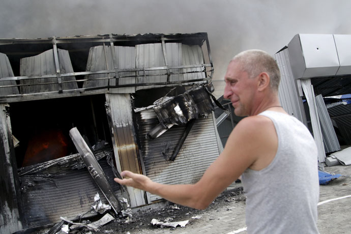 A man reacts next to a shop which was damaged by a recent shelling, at a local market in Donetsk, Ukraine, June 3, 2015. (Reuters/Alexander Ermochenko)