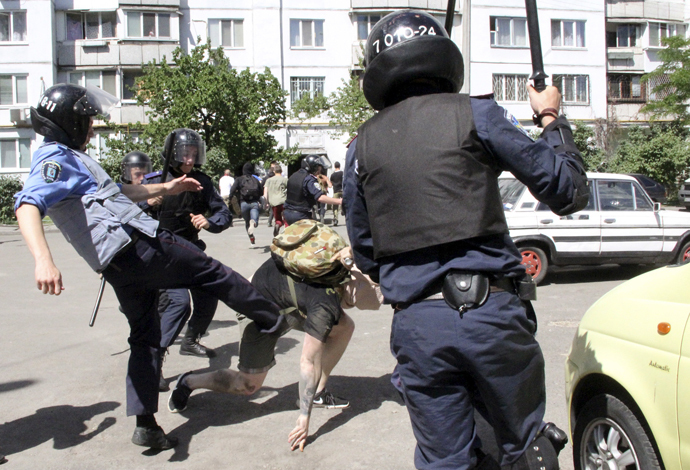 Interior Ministry members attack an anti-gay protester during the so-called Equality March, organized by a lesbian, gay, bisexual and transgender (LGBT) community, in Kiev, Ukraine, June 6, 2015. (Reuters / Maksym Kudymets)