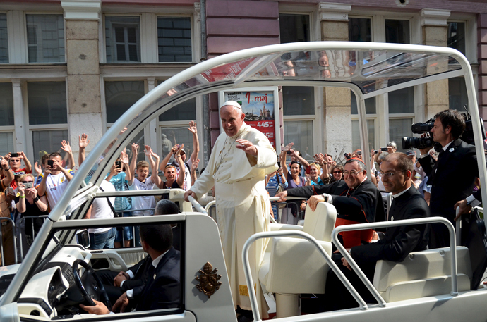 Pope Francis waves from his 'Popemobile' along a street in Sarajevo, Bosnia and Herzegovina June 6, 2015. (Reuters / Stringer)