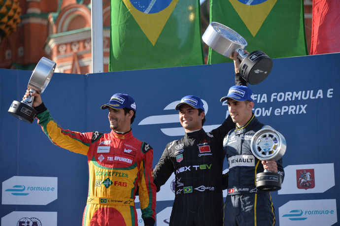 Winners of the FIA Formula E Championship in Moscow during the awarding ceremony. From left: Lucas di Grassi of the Audi Sport Abt team, second place; Nelson Piquet Jr. of the NEXTEV TCR team, first place, and Sebastien Buemi of the e.dams-Renault, third place. (RIA Novosti / Alexey Kudenko)