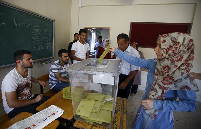 A woman casts her ballot at a polling station during the parliamentary election in Diyarbakir, Turkey, June 7, 2015. (Reuters/Osman Orsal)