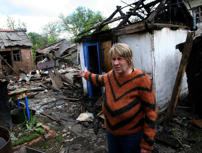A woman by her ruined house after a Ukrainian military artillery attack on Gorlovka, Donetsk region. (RIA Novosti/Igor Maslov)