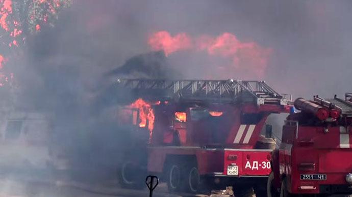 Fire engine, ambulance ablaze at Ukraine oil depot fire (VIDEO)