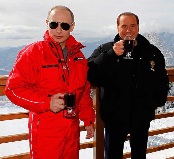 Russian President Vladimir Putin (L) and Former Italian Prime Minister Silvio Berlusconi (Reuters / Dmitry Astakhov)