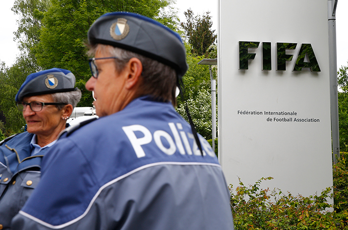 Police officers stand in front of the FIFA headquarters during an extraordinary Executive Committee meeting in Zurich, Switzerland (Reuters / Arnd Wiegmann)