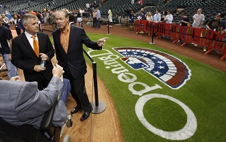 Houston Astros owner Jim Crane (R) and General Manager Jeff Luhnow (L) on Opening Day in Houston March 31, 2013. (Reuters/Richard Carson)