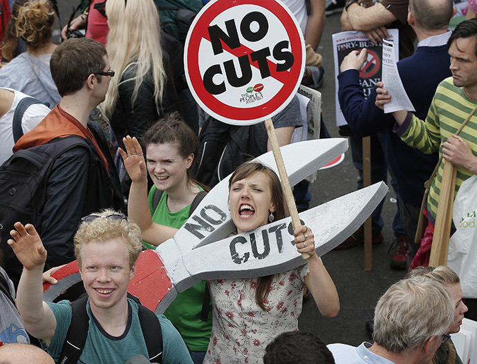 Demonstrators march during an anti-austerity protest in central London, Britain June 20, 2015. (Reuters/Peter Nicholls)