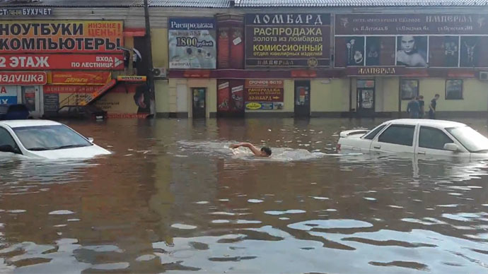Swim to your car, it's 'normal'! Downpour turns roads to rivers in Russian cities (PHOTOS)