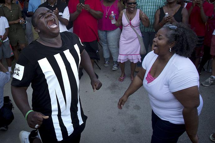 People sing hymns outside Emanuel African Methodist Episcopal Church in Charleston, June 20, 2015. (Reuters/Carlo Allegri)