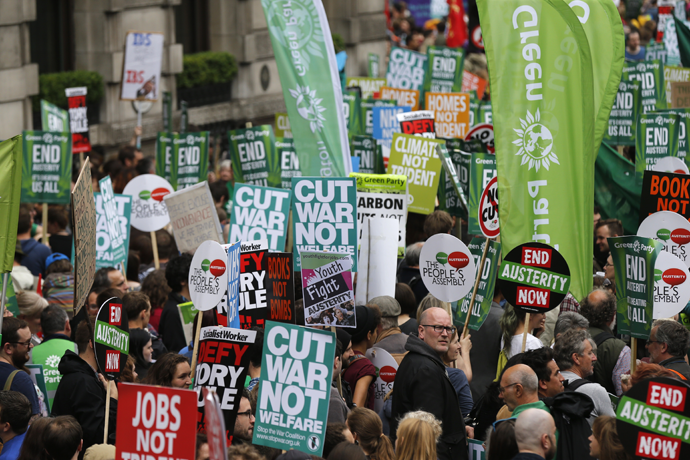Demonstrators march during an anti-austerity protest in London, Britain June 20, 2015. (Reuters / Suzanne Plunkett)