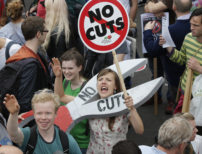 Demonstrators march during an anti-austerity protest in central London, Britain June 20, 2015. (Reuters / Peter Nicholls)