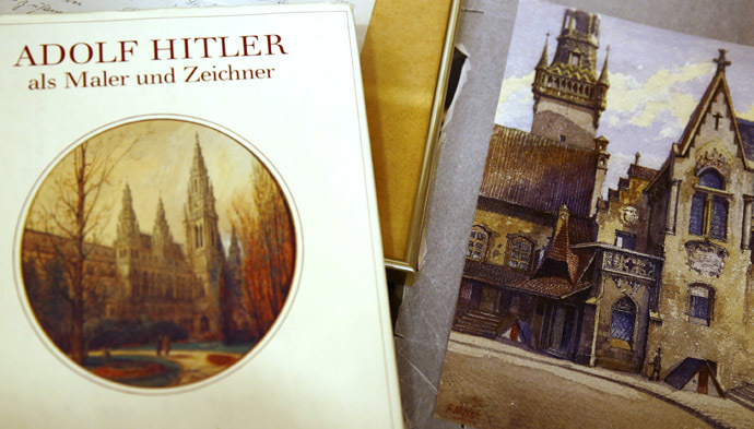 A watercolour of the old registry office in Munich by former German dictator Adolf Hitler lies next to a catalog of his paintings and drawings at Weidler auction house in Nuremberg. (Reuters / Kai Pfaffenbach)