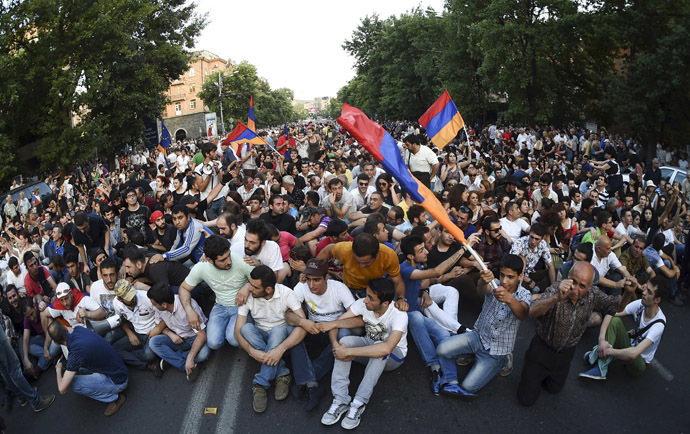 Protesters gather during a rally against a recent decision to raise public electricity prices in Yerevan, Armenia, June 23, 2015. (Reuters / Hayk Baghdasaryan)