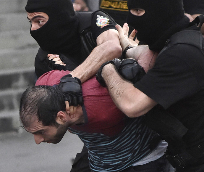 A demonstrator is detained by riot police during a rally against a recent decision to raise public electricity prices in Yerevan, Armenia, June 23, 2015. (Reuters / Vahram Baghdasaryan)