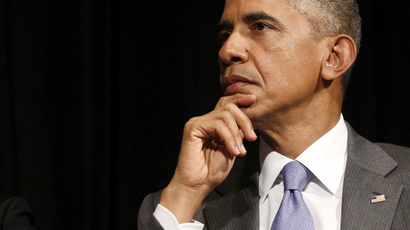 Obama signs bill giving himself fast-track powers for trade deals