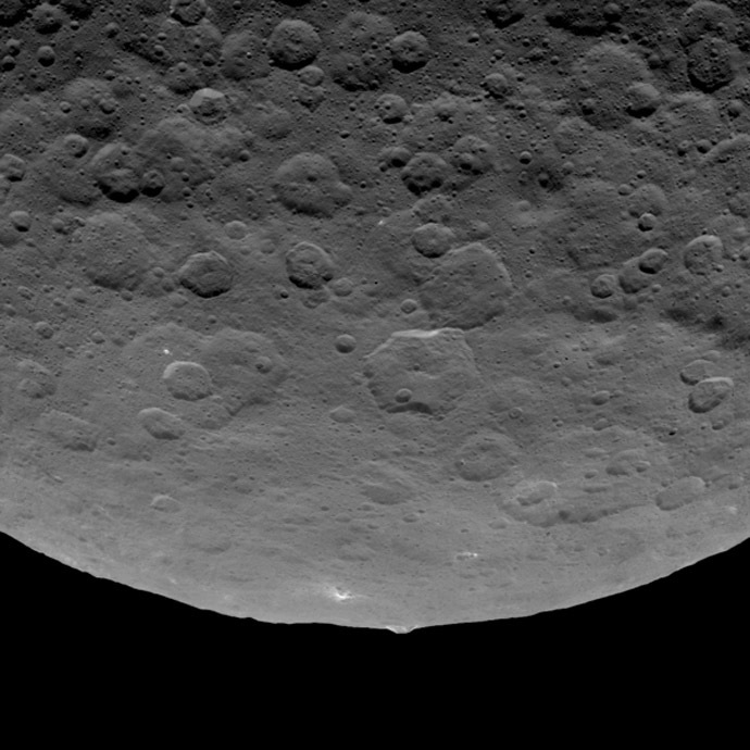 Short caption: This image, taken by NASA's Dawn spacecraft on June 14, 2015, shows an intriguing mountain on dwarf planet Ceres protruding from a relatively smooth area. (Image credit: NASA/JPL-Caltech/UCLA/MPS/DLR/IDA)