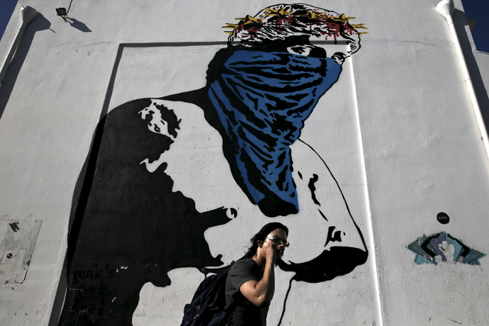 "Graffiti ""Athena vs Europa, Resist vs Submit"" made by French street artist Goin in Athens (Reuters / Alkis Konstantinidis)"
