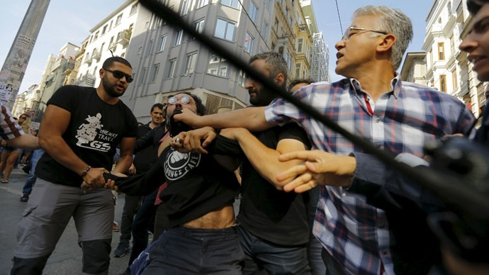 Plainclothes police officers disperse LGBT rights activists before a Gay Pride Parade in central Istanbul, Turkey, June 28, 2015.(Reuters / Huseyin Aldemir)