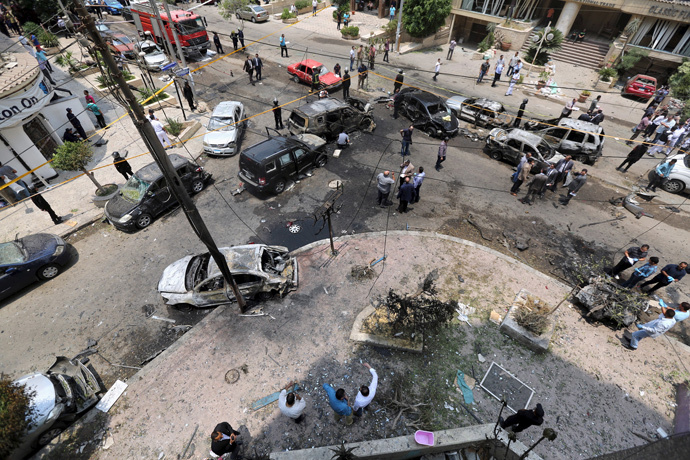 A view shows burnt cars at the site of a car bomb attacked the convoy of Egyptian public prosecutor Hisham Barakat near his house at Heliopolis district in Cairo, Egypt, June 29, 2015. (Reuters / Mohamed Abd El Ghany)