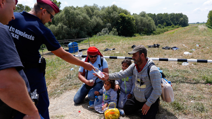 Hungarian police fire tear gas to 'pacify' overcrowded migrant camp