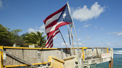 Puerto Rico and U.S. flags. (Reuters / Ana Martinez)