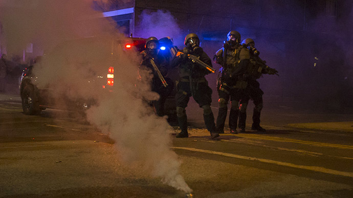 Justice Dept. blasts Ferguson police response to protests in leaked report