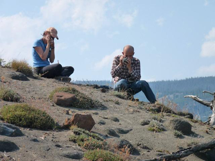 ASU professor Christy Till strives to better understand the potential for future eruptions at Yellowstone volcano by studying those in the recent past. She and paper co-author Jorge Vazquez examine Yellowstone lava in the field (Photo by Naomi Thompson)