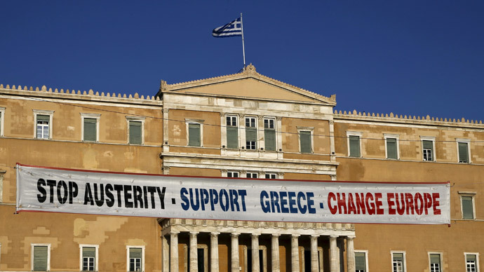 A banner hangs in front of the parliament during a pro-government rally calling on Greece's European and International Monetary creditors to soften their stance in the cash-for-reforms talks in Athens, June 17, 2015. (Reuters / Yannis Behrakis)