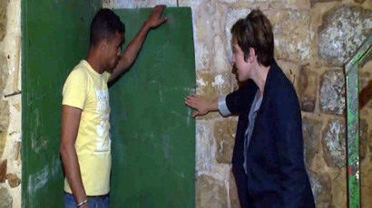 ​House divided: Israelis, Palestinians live under same Hebron roof, separated by brick wall