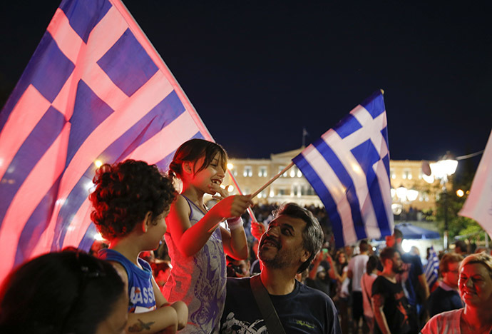 Anti-austerity 'No' voters celebrate the results of the first exit polls in front of the Greek parliament in Syntagma Square in Athens, Greece July 5, 2015. (Reuters / Marko Djurica)