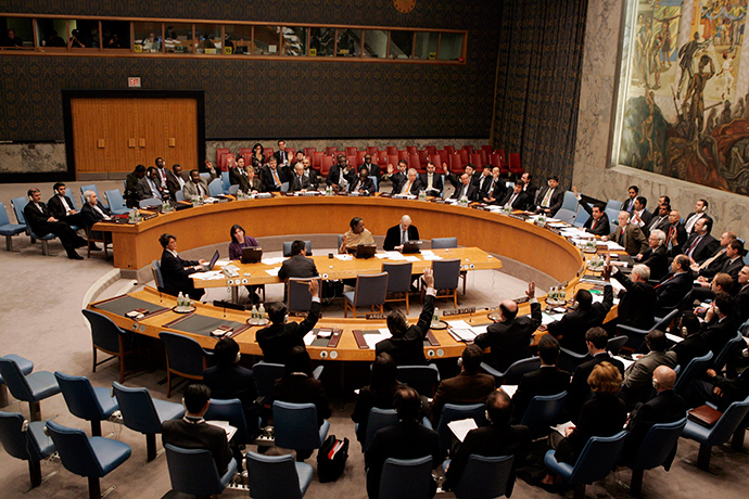 Members of the U.N. Security Council raise their hands during a unanimous vote on a resolution authorizing trade sanctions against Iran for its nuclear program at the United Nations headquarters in New York December 23, 2006 (Reuters)