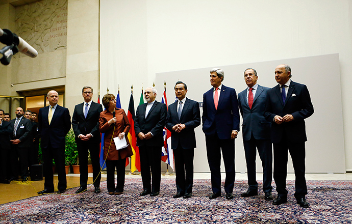 European Union foreign policy chief Catherine Ashton (3rd L) delivers a statement during a ceremony next to British Foreign Secretary William Hague, Germany's Foreign Minister Guido Westerwelle, Iranian Foreign Minister Mohammad Javad Zarif, Chinese Foreign Minister Wang Yi, U.S. Secretary of State John Kerry, Russia's Foreign Minister Sergei Lavrov and French Foreign Minister Laurent Fabius (L-R) at the United Nations in Geneva November 24, 2013 (Reuters / Denis Balibouse)