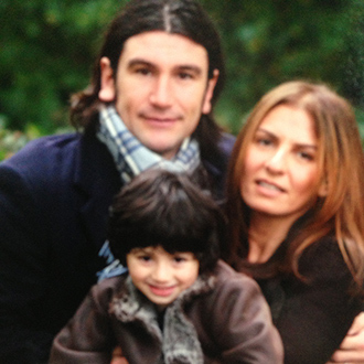 This is a picture of Emmy Georgiou, her husband and child Amelio the year of the terror attack