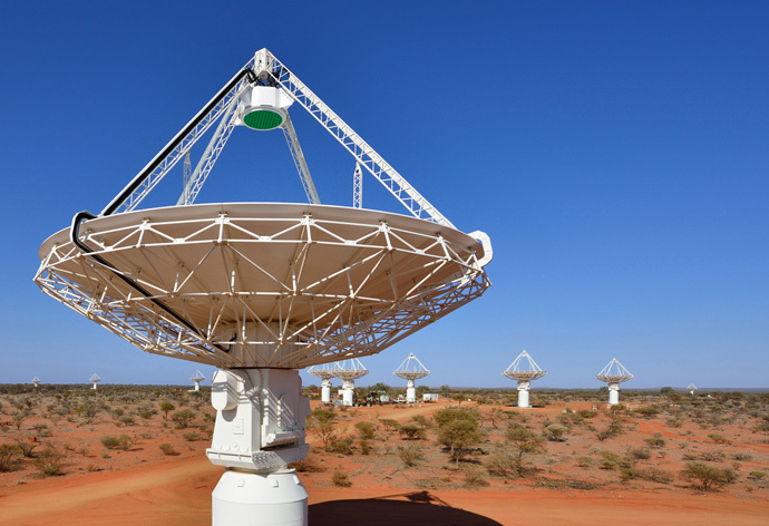 Close up of an ASKAP antenna with several more in the background. (image from wikipedia.org by CSIRO)