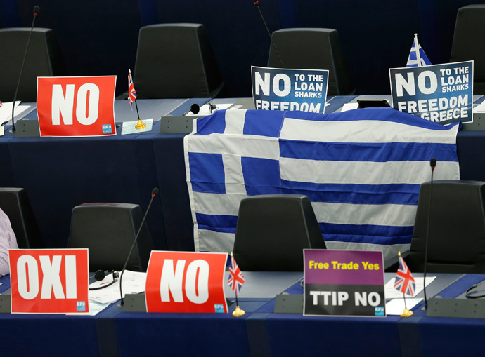 "Posters with the word ""No"" (Oxi) and a Greek flag are seen on the desks of Members of the European Parliament during a debate on Greece at the European Parliament in Strasbourg, France, July 8, 2015. (Reuters / Vincent Kessler)"