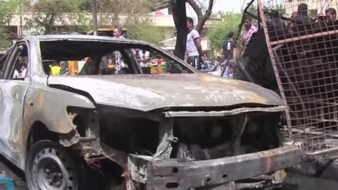 Dozens killed in series of suicide & car bombings in Baghdad