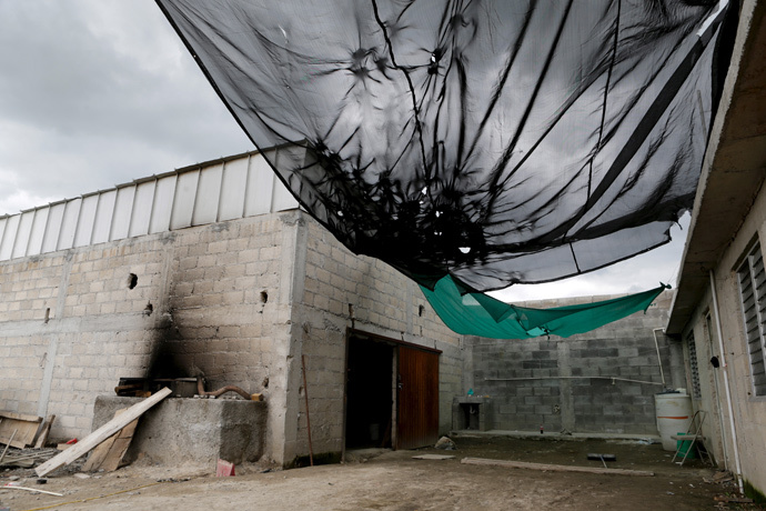 General view of the entrance of a warehouse where a tunnel, connected to the Altiplano Federal Penitentiary and used by drug lord Joaquin 'El Chapo' Guzman to escape, was located in Almoloya de Juarez, on the outskirts of Mexico City, July 12, 2015. (Reuters / Tomas Bravo)