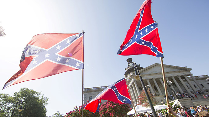 Confederate flags fly over Charleston to protest activist's speech