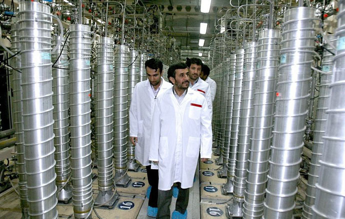 A handout picture released by Iranian President Mahmoud Ahmadinejad's official website shows him (R) listening to an expert during a tour of Tehran's research reactor centre on February 15, 2012 (AFP/President.ir)