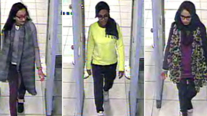 A combination of handout CCTV pictures received from the Metropolitan Police Service (MPS) on February 23, 2015 shows (L-R) British teenagers Kadiza Sultana, Amira Abase and Shamima Begum passing through security barriers at Gatwick Airport, south of London, on February 17, 2015. (AFP/Metropolitan Police)