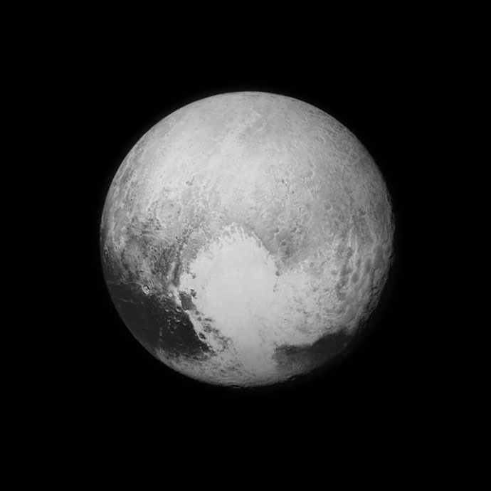 "Three billion miles away, Pluto has sent a ""love note"" back to Earth, via NASA's New Horizons spacecraft. (Photo credit: NASA/JHU APL/SwRI)"
